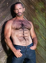 Tim Kelly shows his muscled hairy body